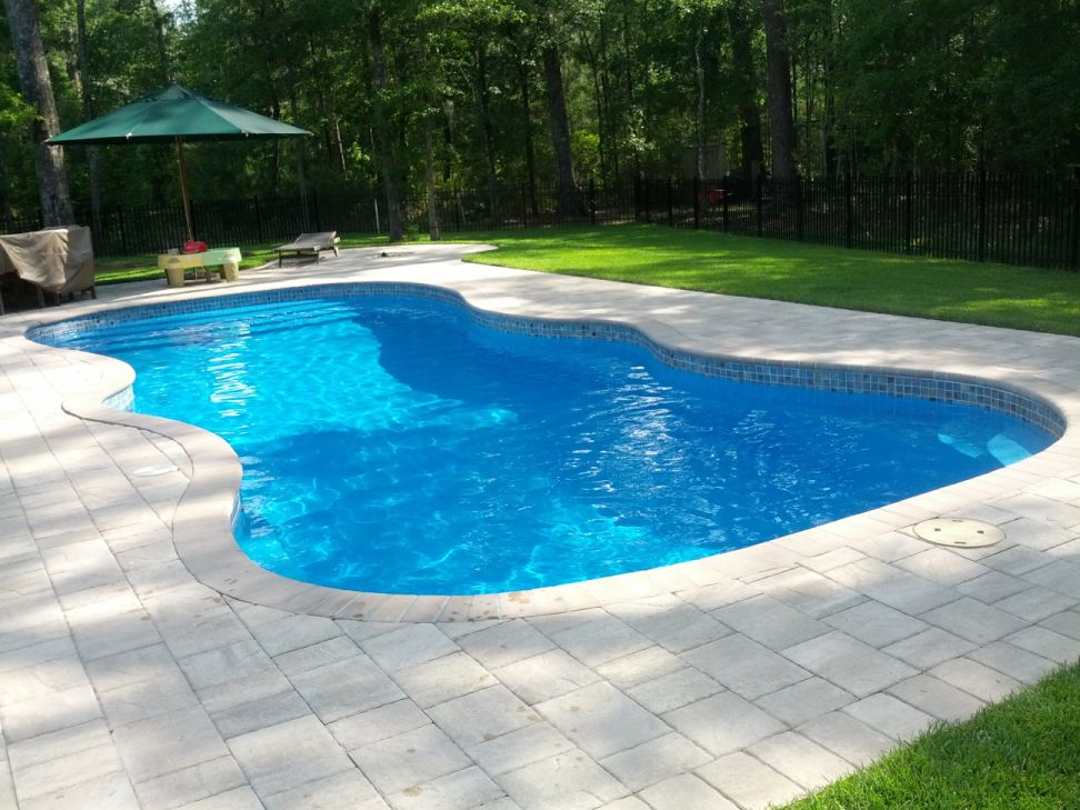 Crystal pools fiberglass swimming pools for Swimming lap pools